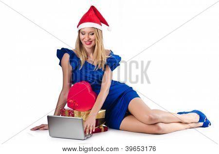Santa woman with laptop on white