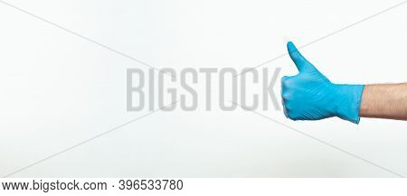 Doctor Hand With Glove Showing Like Gesture Or Thumbup As Approval, Accept Or Done Concept. Copy Spa