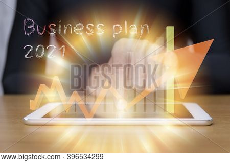 Businessman Hand Touching On 2021 Virtual Screen With Tablet On Desk. Business Concept New Year. Han