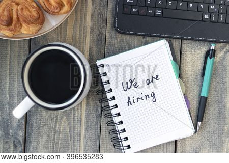 We Are Hiring. Job Recruting Concept. Words We Are Hiring In Notebook On The Working Table.