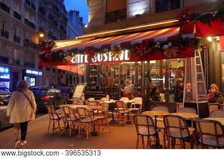 Paris, France - December 10, 2019: People Visit Local Bistro In 7th Arrondissement Of Paris, France.