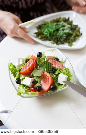 Fresh Vegetables Salad Bowl On A Cafe Table