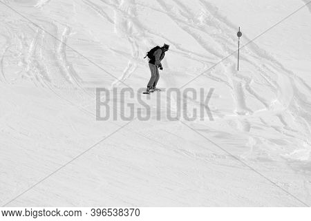 Snowboarder Downhill On Snowy Off-piste Slope After Snowfall At Cold Winter Day. Black And White Ton