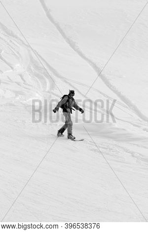 Snowboarder Downhill On Snowy Off-piste Slope After Snowfall At Winter Day. Black And White Toned Im