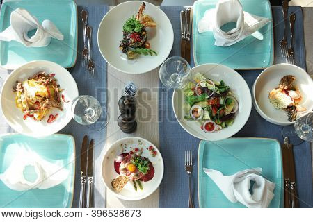 Served Lunch In Restaurant. Top View Of Tasty Dishes Are On The Table. Beautifully Served Table For