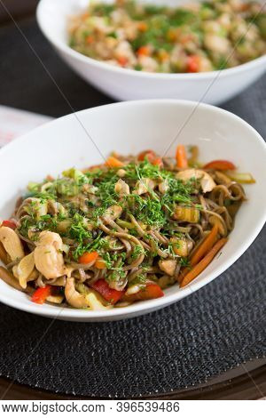 Bowl Of Fried Noodles Served On A Table