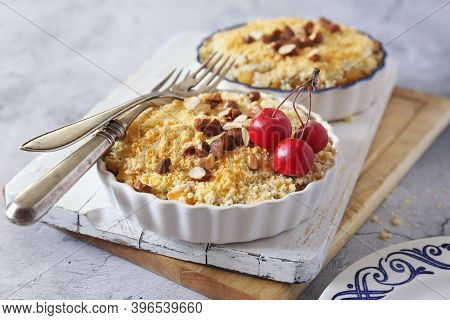 Apple Crumble With Almonds, Two Portions On Light Gray Background, Red Paradise Apples Dressing