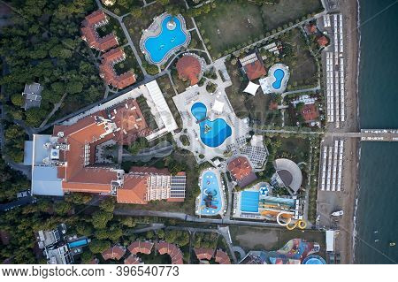Aerial View Of Water Park And Coastline Of Resort Hotel. Drone View Of Luxury Hotel With Swimming Po