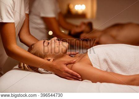 Couples Massage. Girlfriend And Boyfriend Enjoying Relaxing Beauty Treatment Lying In Masseurs Bed A