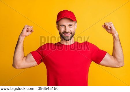 Photo Of Strong Guy Raise Arms Show Muscles Wear Red T-shirt Headwear Isolated Yellow Color Backgrou