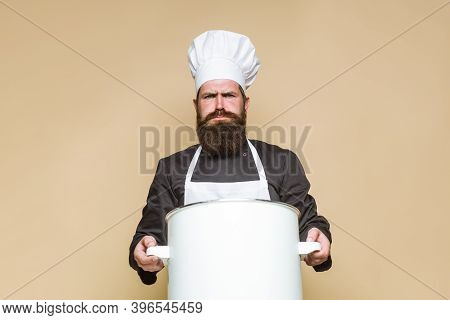 Bearded Chef With Big Pot. Cooking. Bearded Chef In Uniform. Kitchenware. Cook. Kitchen. Food