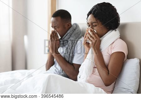 African American Man And Woman Got Cold, Sneezing Their Noses, Staying In Bed During Illness, Copy S