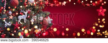 Christmas Tree with Decorations And Stars. Red Winter Background