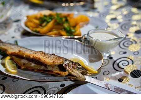 Close Up Of Fish Kebab Or Grilled Fish On Charcoal Skewer On Plate