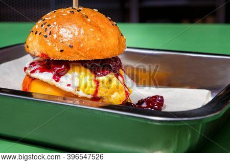 Close Up Tasty Burger With Different Filling Served On Tray