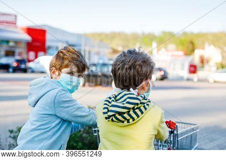 Two Kids Boys In Medical Mask As Protection Against Pandemic Coronavirus Disease. Children Using Pro