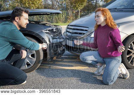 Man And Woman Quarrel After Bad Car Accident