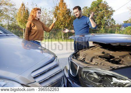 Man And Woman Arguing After A Car Crash