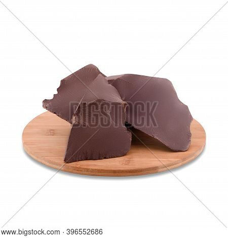 Broken Chocolate Pieces On Wood Board Isolated On White Background, Copy Space. Dark Chocolate Chunk