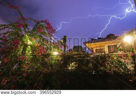 Lightning Strike Residential Neighborhood. Large Bright Lightning Close Up. Mediterranian Winter Nig