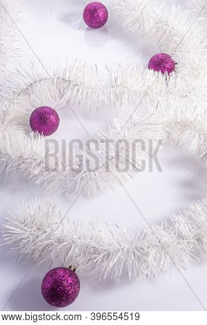 Vertical Shot Christmas Flatlay With Purple Decorations On White Background