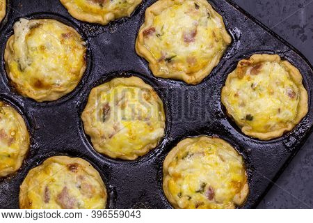 Mini Quiches With Bacon, Egg, Cheese And Parsley In Baking Tin - Savoury Tartlets  Top View Close Up