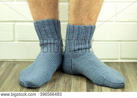 Handmade Socks, Warm And Do-it-yourself Knitted Socks Close-up. Photo Of Male Legs In Knitted Socks