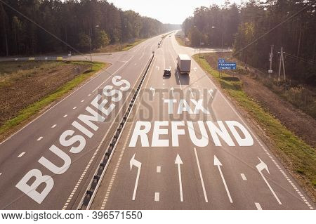 Business And Finance Concept. Transport Is Moving Along The Road, The Text Of Business And Tax Refun