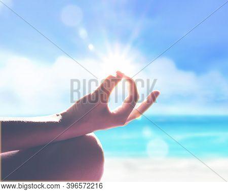 Yoga, Meditation And Healthy Lifestyle On The Summer Beach.