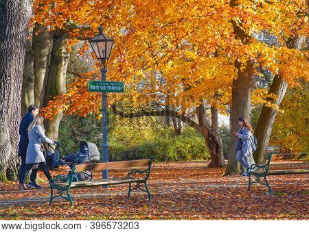 Graz, Austria-november 18, 2019: People Walking And Relaxing In The Park, In Sunny Autumn Day. Color