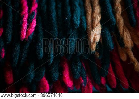 Cold Season Home Warmth And Cosiness. Woolen Braided Thick Threads Tassels Of A Warm Traditional Pla