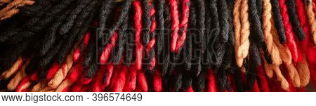 Cold Season Home Warmth And Cosiness. Woolen Braided Thick Tassels Of A Warm Traditional Plaid Site