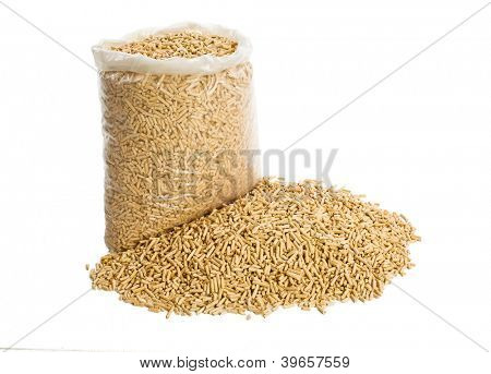 wooden pellets in plastic bag on white background