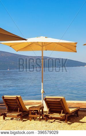 Summer Beach Vacations. Sunny Day At The Beach.  Montenegro, Adriatic Sea, View Of Bay Of Kotor Near
