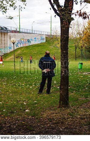 Milan, Italy - November, 05: Italian Traffic Warden Observe The Migrants Playing Soccer In The Park