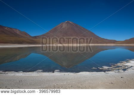 Reflections Of Mountains In The Clear Water Of The Green Lake (laguna Verde) On The Bolivian Altipla