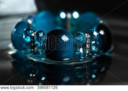 Beautiful Blue Bracelet On A Black, Natural Background. Bracelet For Woman.