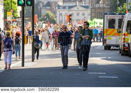 London - September 20, 2019: People Walking In Front Of An Extinction Rebellion Protest In London