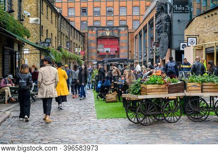 London - September 30, 2019: A Busy Outside Dining Area In Camden Market Surrounded By Food Vendors