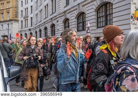 London, Uk - October 18, 2019: A Parade Of Extinction Rebellion Protesters With Their Hands Painted