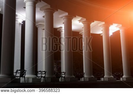 Illuminated Columns With White Light. Many Columns On The House