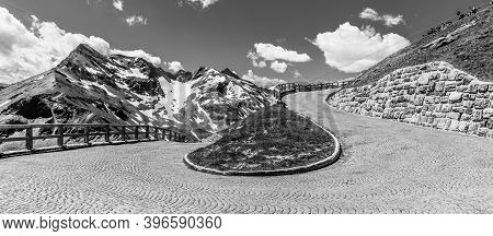 Mountain Cobbled Road Serpentine. Sharp Curve With Mountain Tops On Background. High Tauern, Austria
