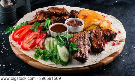 Mixed Grilled Meat Juicy Barbecue Pork Ribs And Dry Chicken Wings On Dark Background, Grilled Chicke
