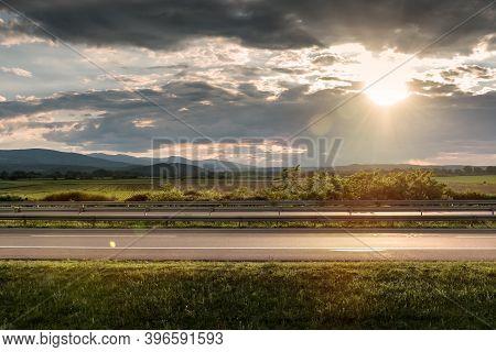 Empty Highway Asphalt Road And Beautiful Sky Sunset Landscape. Landscape Scene And Sunrise Above Roa