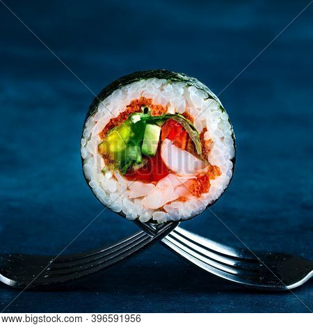 Traditional Japanese Futomaki Roll Stuffed With Tobiko Caviar, Cucumber, Crab Meat And Tomato, Futom