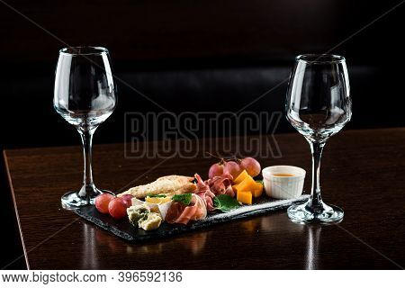 Antipasto And Catering Cheese Platter With Assorted Cheeses Appetizer For Wine. Italian Cheese With