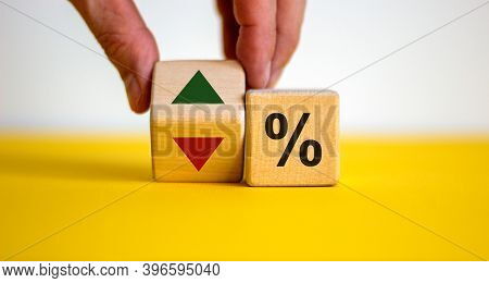 Wooden Cubes Changes The Direction Of An Arrow Symbolizing That The Interest Rates Are Going Down Or
