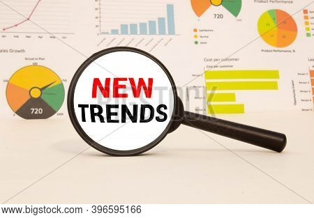 New Trends Text Written On Magnifying Glass. Main Trend Of Changing Something. Popular And Relevant