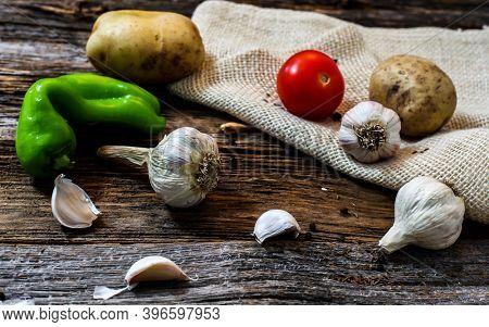 Garden vegetables on rustic wooden table