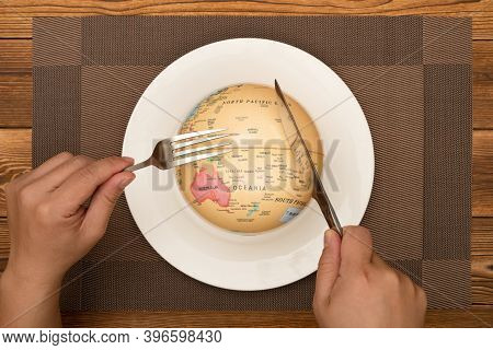 Man Eating A Globe Concept Of Overusing The Resource Of Nature